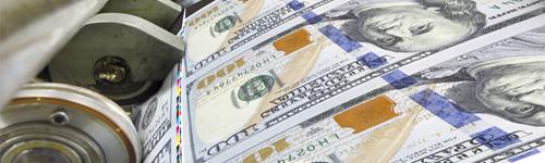 Close up of dollar banknotes being printed