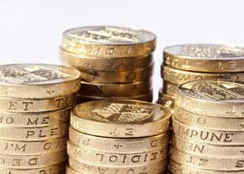 Photo of a stack of pound coins.