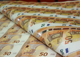 Sheets of new 50 euro banknotes waiting to be cut.