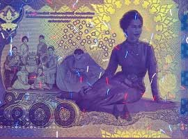 Thailand commemorative banknote 2016 under UV light.