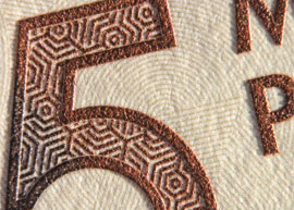 Close up image of intaglio ink depicting the number 5 denomination.