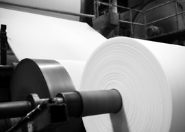 Roll of paper manufactured at a paper mill.