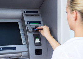 Image of a lady using an ATM.