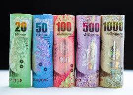 Image of rolls of Thailand banknotes